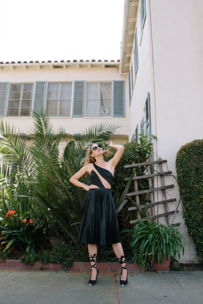 Investment Piece, fashion blogger, high fashion, leather swim, pleats, leather skirt, Norma Kamali, swim, CA, TX